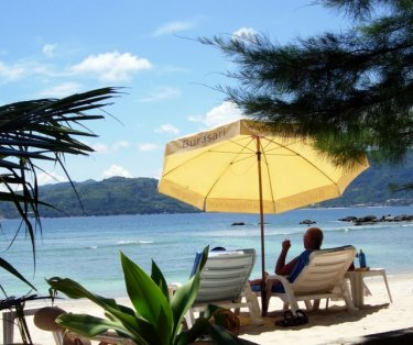 This side of Paradise. The restaurant is good and the view across to Patong makes this small beach a great place to be.