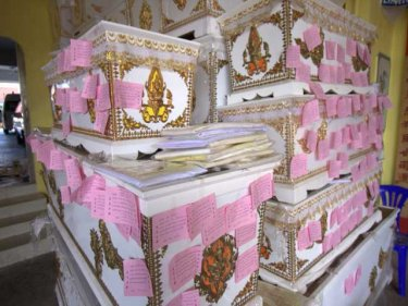Coffins for the poor at a charity foundation on Phuket, carrying merit-making coupons for Songkran, the Thai New Year. The container dead are likely to be buried as paupers in similar coffins in Ranong.