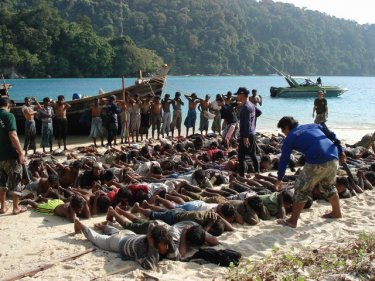 More than 200 Burmese Muslim men are arrested and taken to Surin Island for processing by the Royal Thai Navy.