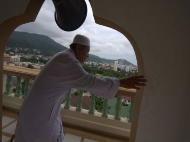 Imam Marok Thongyn in the tower of  the new Patong mosque