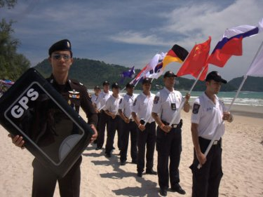 International flags fly at Patong for a mock rescue, comforting for some
