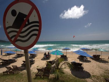 Warning sign at Surin beach, where one of four swimmers drowned