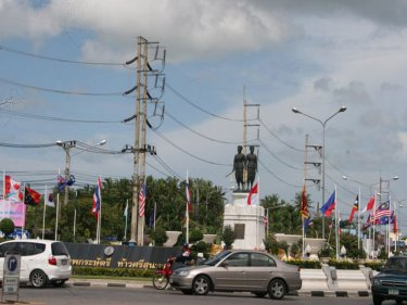 The Heroines Monument surrounded by national flags for the Asean Regional Forum