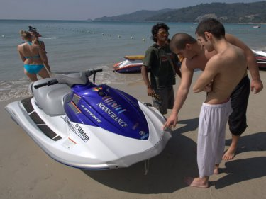 Patong beach nightmare: Jetski operator and tourists look at the damage