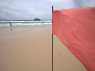 A red flag on a Phuket beach: Now Phuket is being red-flagged