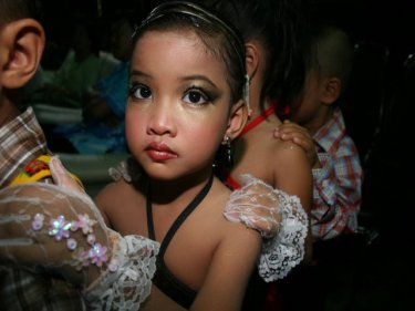 Young lady all dressed up for the Loy Kratong festival in Karon