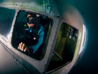 A diver in the cockpit of one of the sunken squadron that vanished