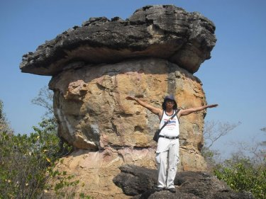 Man pretending to be an AirAsia flight at a Udonthani rock landmark