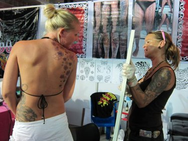 Flower power from the art of a tattooist at Phuket's first tattoo convention