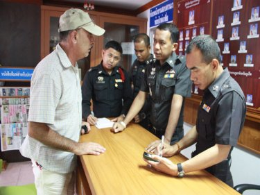 Police at Patong talk to the mysterious 'Dean Mancuso'