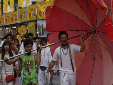 Unlikely to be shaded, Phuket's umbrella fella on parade today