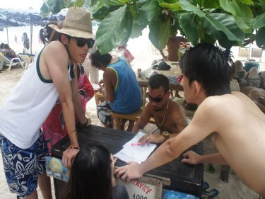 Tourists and a Phuket jet-ski operator discuss the damage and payment