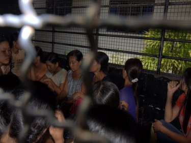Burmese in a van at Immigration, Ranong: overstayers share facilities