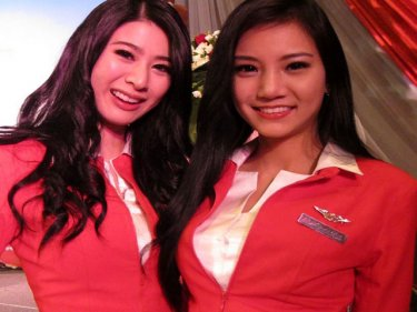 Two of the Phuket-born attendants on the new AirAsia flights to Bali