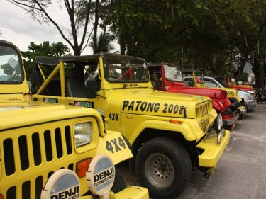 Present-day parking along Patong's beach road: change is coming