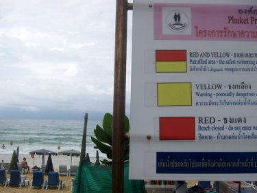 Karon, the Phuket beach where nobody reads the signs or sees the flags