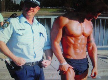 Bodybuilder Zyzz clowns with a policeman in Australia