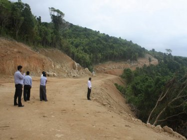 Officials examine the kilometre-long road on Phuket's west coast