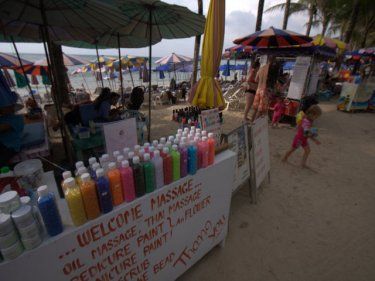 Phuket's future at risk as tourists play ''find the sand'' at beaches
