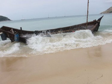 The vessel that carried more than 90 boatpeople to land on a Phuket beack