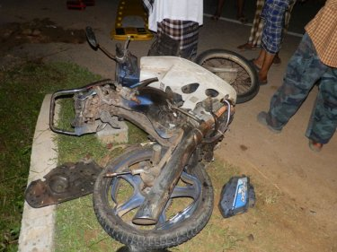 The crashed motorcycle at the scene of the double fatality last night