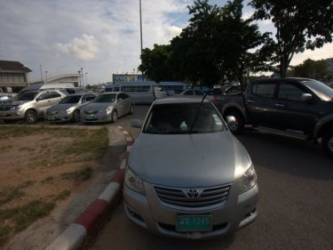 A crush of taxis and limousines leaves no room to park at Phuket airport