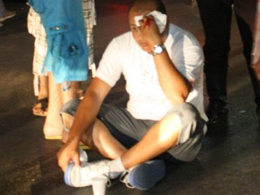 Tourist Ahmed Taha Taha stages a sit-down protest after the tuk-tuk assault