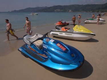 Jet-skis on Phuket's Patong beach, where scams are reported often