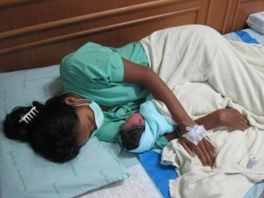 A Burmese mother with newborn in a Phuket hospital corridor, 2010