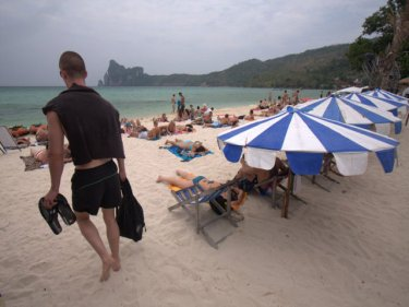 Beautiful Phi Phi loses its tourism lustre as an oil slick strikes a beach