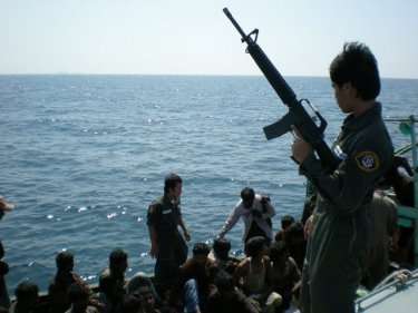 Rohingya boatpeople under the gun in Thailand in 2009