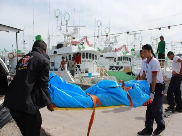 The body is carried away from the spot in the water at Phuket's wharves