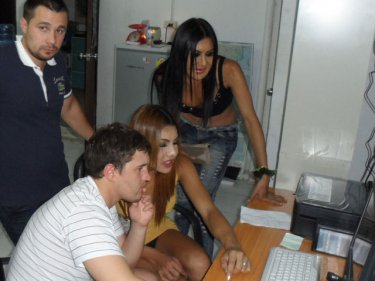 Images of ladyboys being studied at Kathu Police Station after the theft