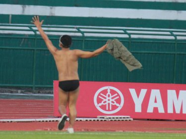 An almost naked Phuket fan celebrates the vital victory tonight