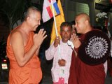 Phuket's Mons Turn Out at Temple to Greet Respected Monk