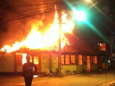 The blaze destroys a Phuket dive shop at 4am today in Kamala