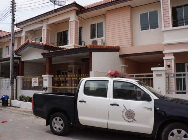 Police examine the Phuket City house where the murder took place