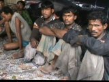 Rohingya Trucked North: Checkpoint Exposes 127 in Minivan Convoy