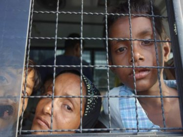 Rohingya boatpeople were quickly transferred to police trucks yesterday