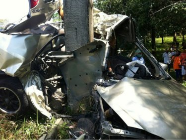 The taxi wrapped around the pole after crashing at speed on Phuket