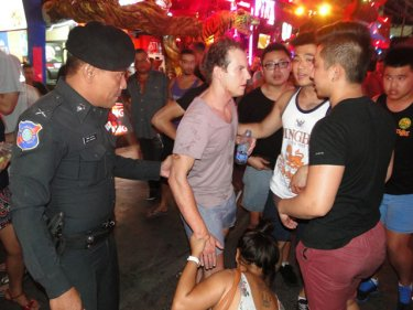 An Australian tourist recovers on Sunday night in Patong's Soi Bangla after being assaulted by three expat men who ran off