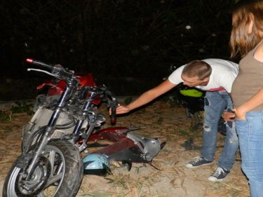 The Russian man's motorcycle being examined last night after the crash