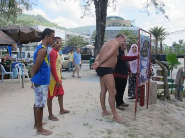 Tourists study a new Phuket jellyfish awareness station