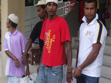Handcuffed Rohingya headed for Phuket Immigration on February 22