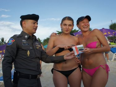 Tourists are given the messsage about jet-skis at Patong yesterday
