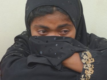 A Rohingya woman cries after her apprehension on Phuket