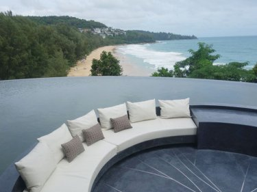 Curling submerged rondel seating offers views over Phuket's Nai Thon