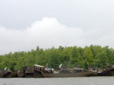 A graveyard for Rohingya boats in Phang Nga, Thailand, pictured in 2008. Thousands stream south looking for sanctuary and find smugglers instead