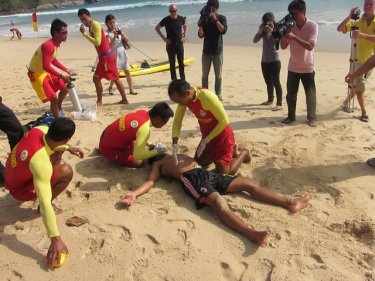 Lifeguards train on Nai Harn beach, near what could be a safety centre