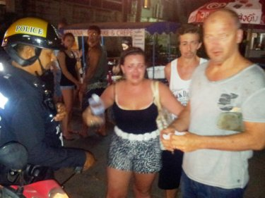 Troubled tourists with police in Patong early today